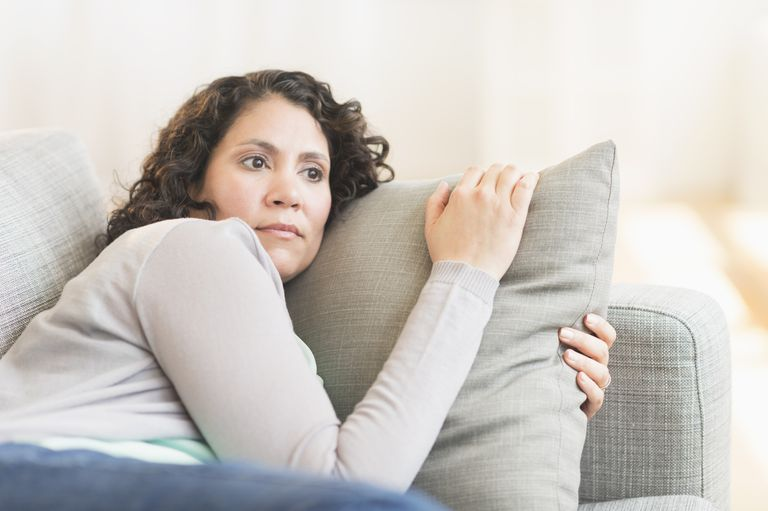 worried woman laying down