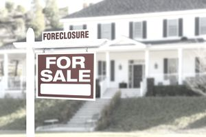 Foreclosure Home For Sale Sign in Front of Large House
