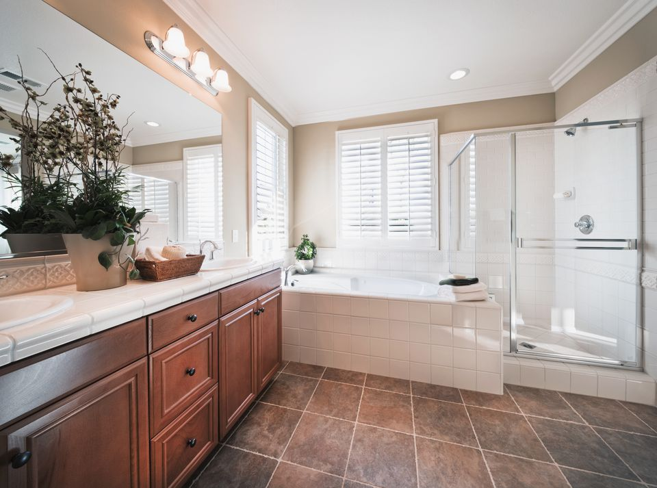 Traditional bathroom with light wood cabinets