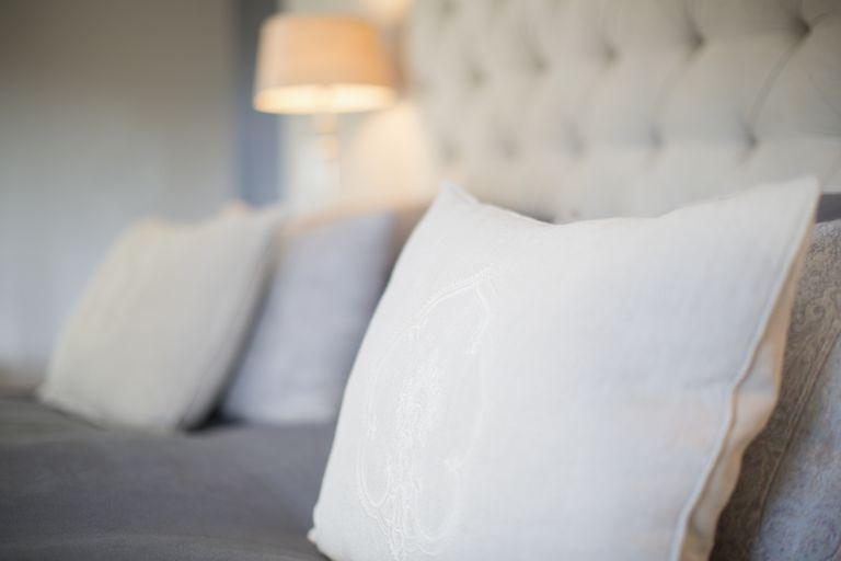 Pillows on bed in luxury bedroom