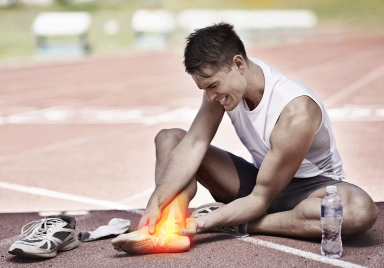 Man holding his leg in pain