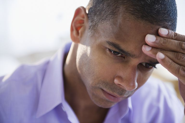 Mixed race man with a headache