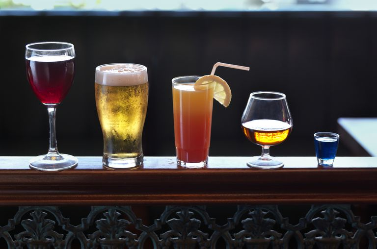 drinks lined up at a bar