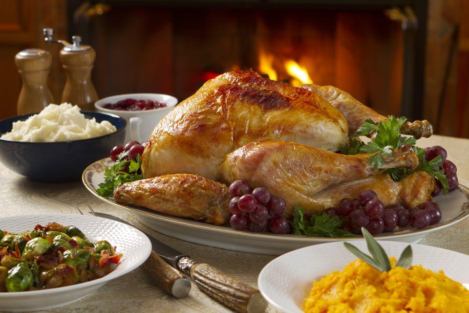 Freshly roasted turkey dinner with vegetables in bowls