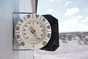thermometer on side of building