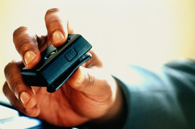 HAND HOLDING PAGER