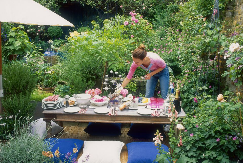 woman setting outdoor table