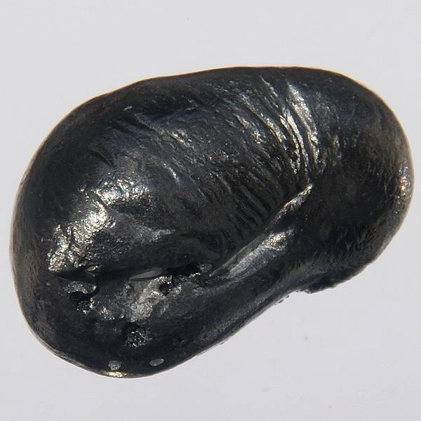 This is a bead of pure beryllium (1.0 x 1.5 cm, 2.5 g).