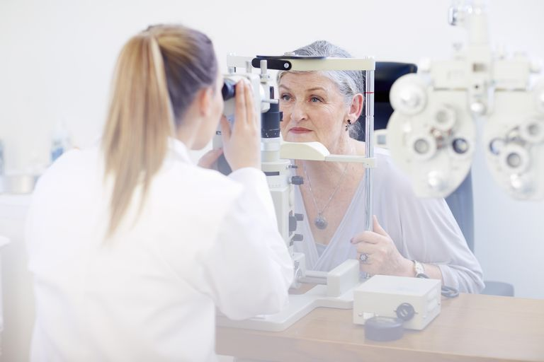 Eye doctor examining senior womans vision