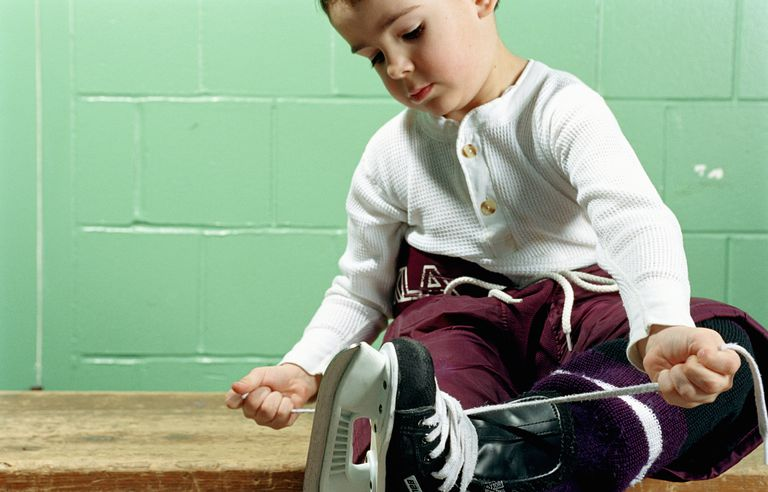 boy tying hockey skates