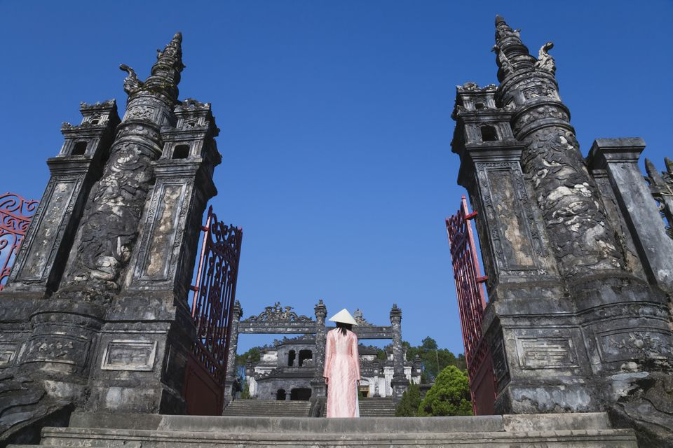 Visitor in ao dai ascending Khai Dinh's tomb, Hue, Vietnam