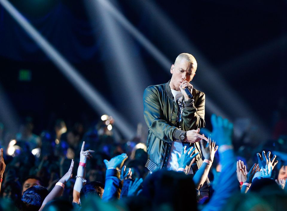 Recording artists Eminem performs onstage at the 2014 MTV Movie Awards at Nokia Theatre L.A. Live on April 13, 2014 in Los Angeles, California.