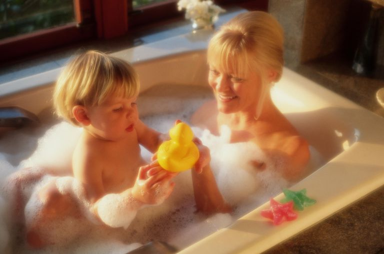 Mother and toddler boy (18-21 months) taking bubble bath