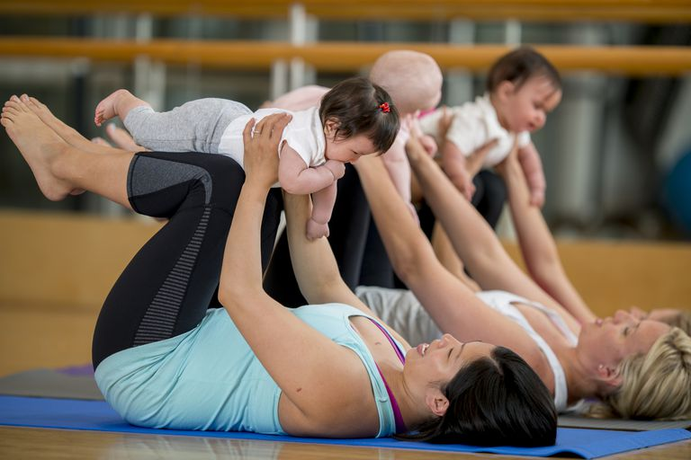 Moms with babies at a mom and baby yoga class