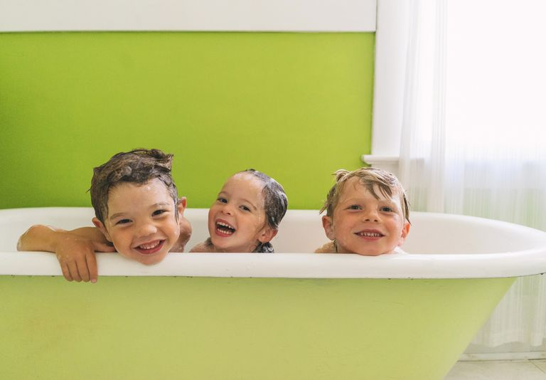 Young children bathing together.