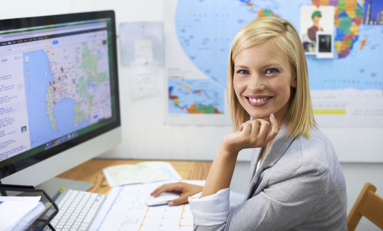 woman with map on computer