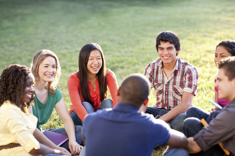 Multi-ethnic group of students talking outside