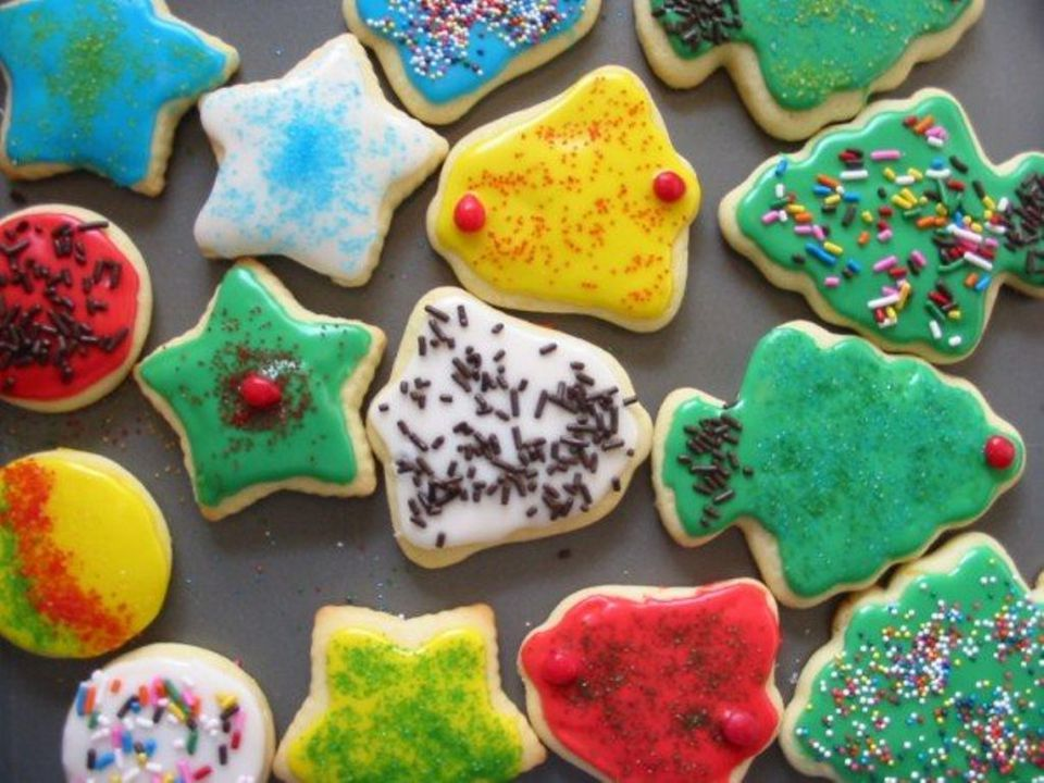 decorated sugar cookies in christmas shapes