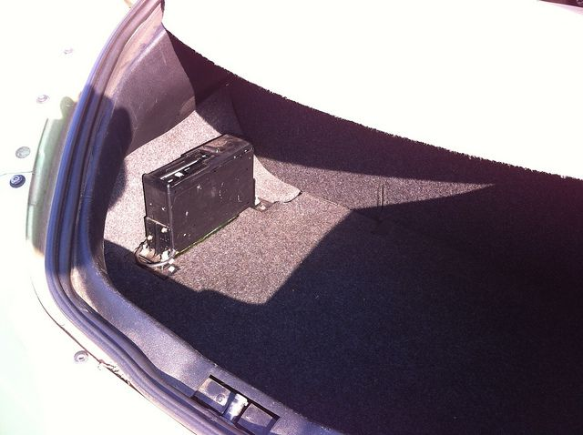 A CD changer in a car trunk.