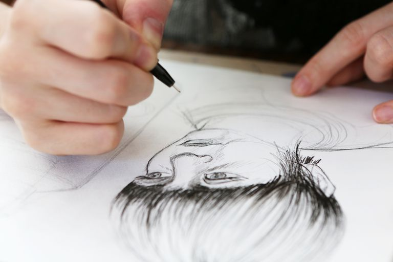 Artist working on a pen and ink drawing