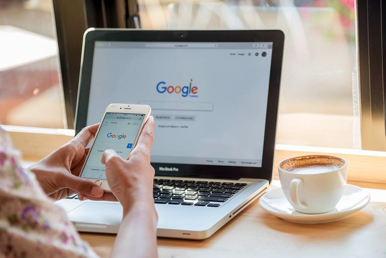 Google searches on phone and laptop