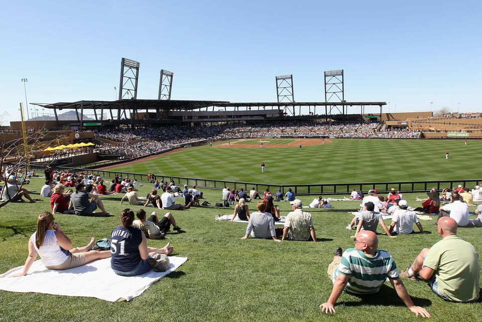 Fans watch the spring training game between the Milwaukee Brewers and the Arizona Diamondbacks at Salt River Fields at Talking Stick on March 9, 2011 in Scottsdale, Arizona.