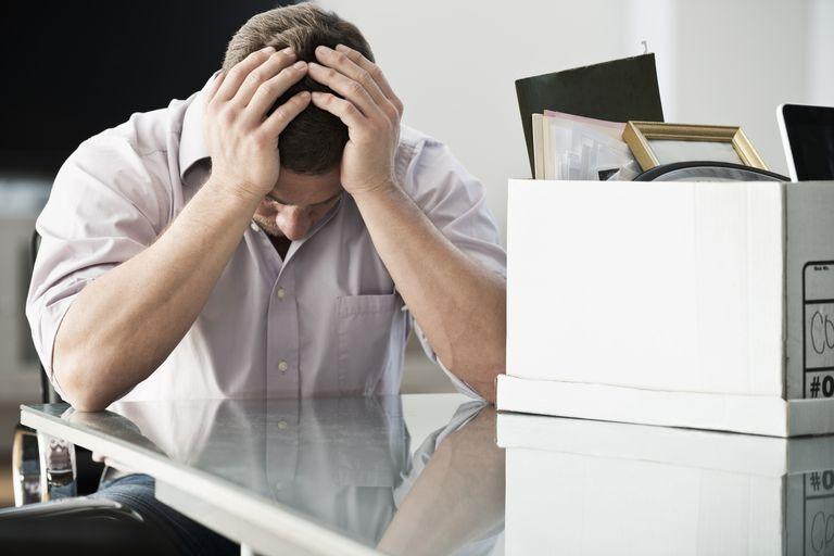 sad man packing up office