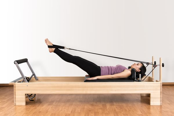 Working Pilates on Reformer Bed