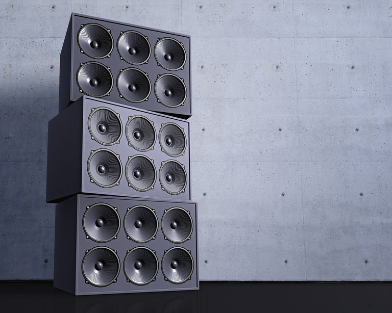 Three large loudspeakers stacked atop one another