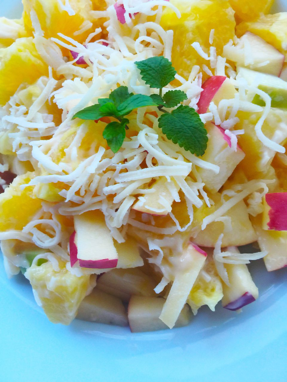 fruit salad with orange, pineapple, and coconut