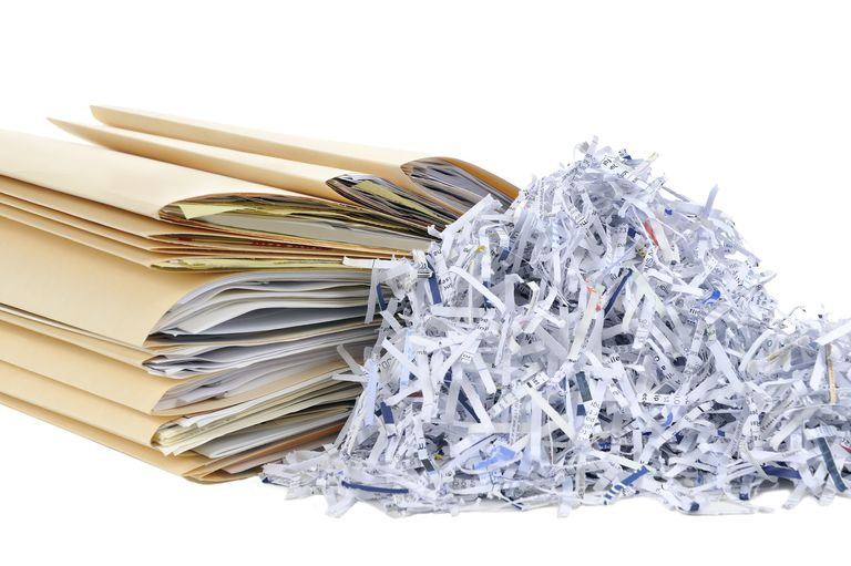 Folders next to shredded documents