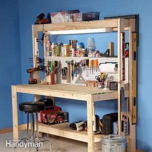 A Workbench With Lower Shelf And Pegboard