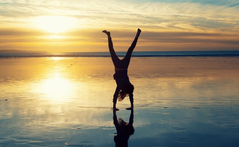 Cartwheels on the beach at sunset