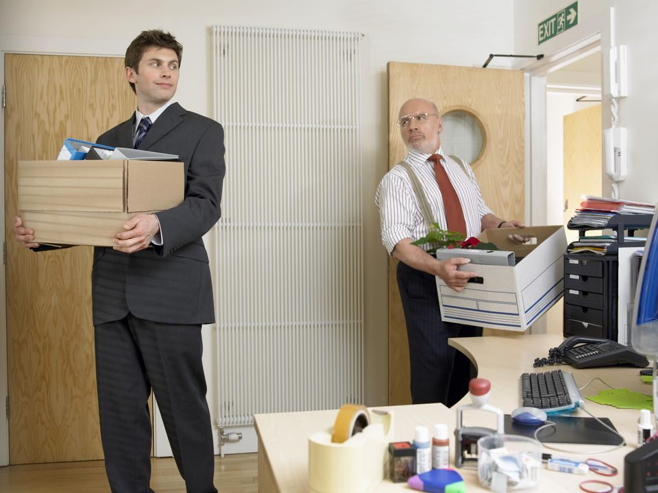 Businessmen Carrying Boxes of Office Equipment