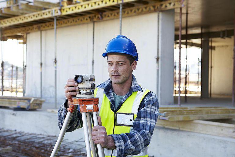 Surveyor on building site