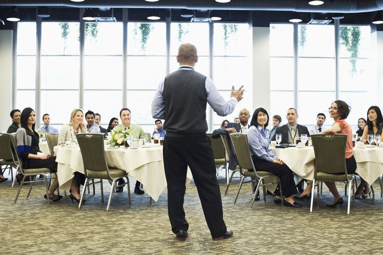 man speaking in front of room