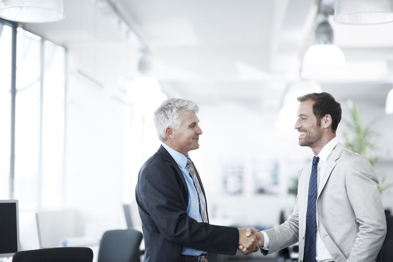 Two business shaking hands