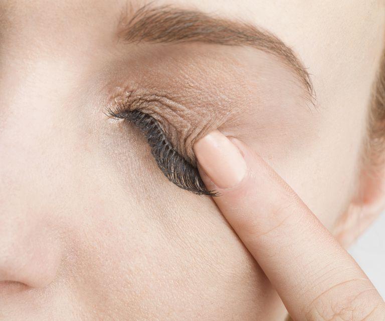 Woman touching eye