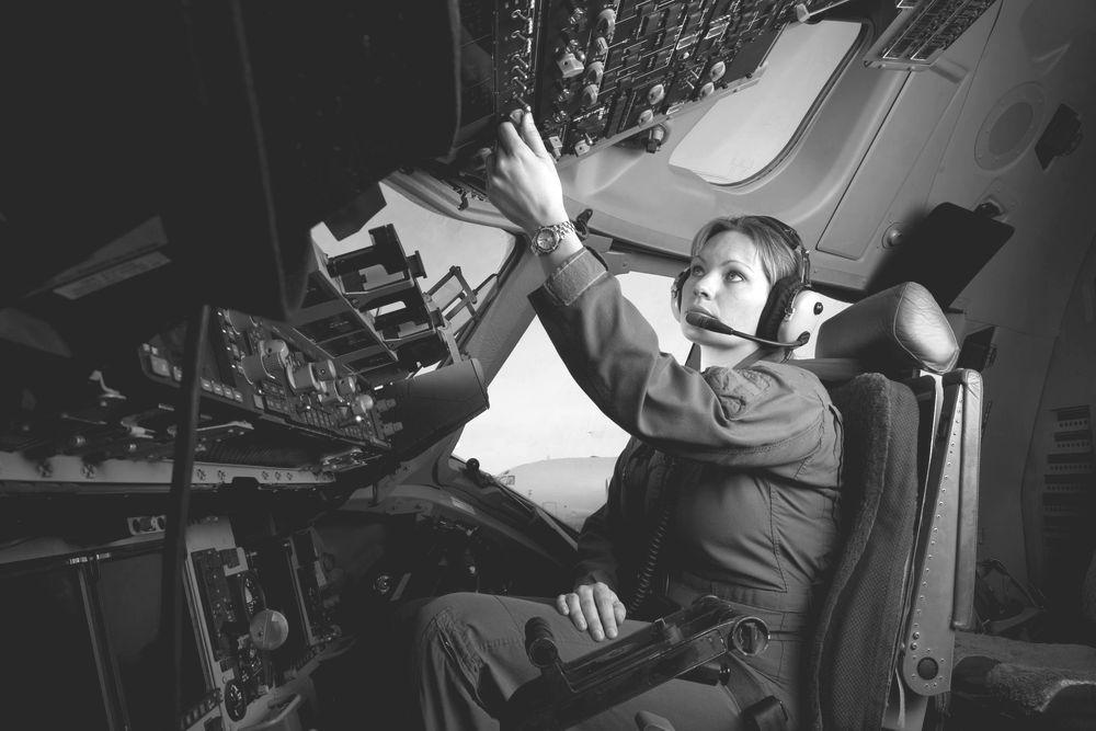 Aircraft pilot conducts pre-flight checks.