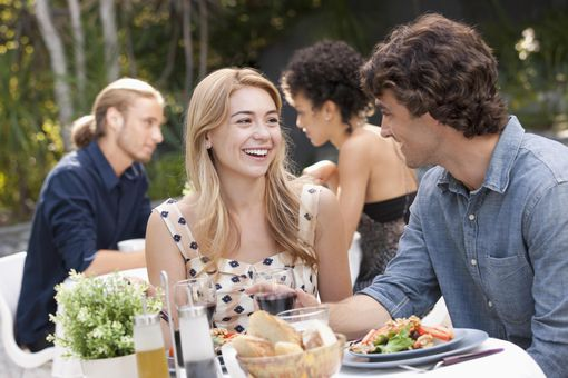 USA, California, Los Angeles, Couple dining in outdoor restaurant