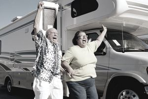a happy couple next to an RV