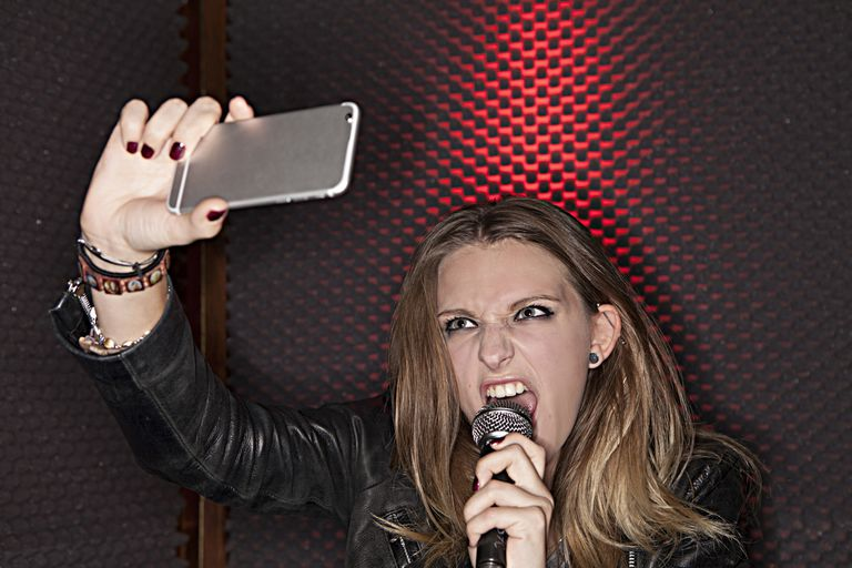 Girl Singing While Taking a Selfie