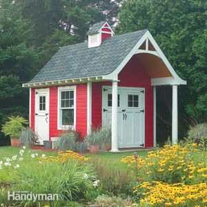 A shed shaped like a schoolhouse.