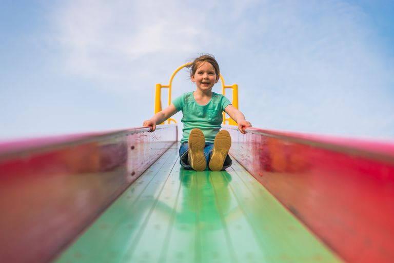 Girl going down slide
