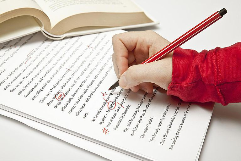 person proofreading book manuscript