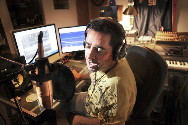 Caucasian man working in music studio