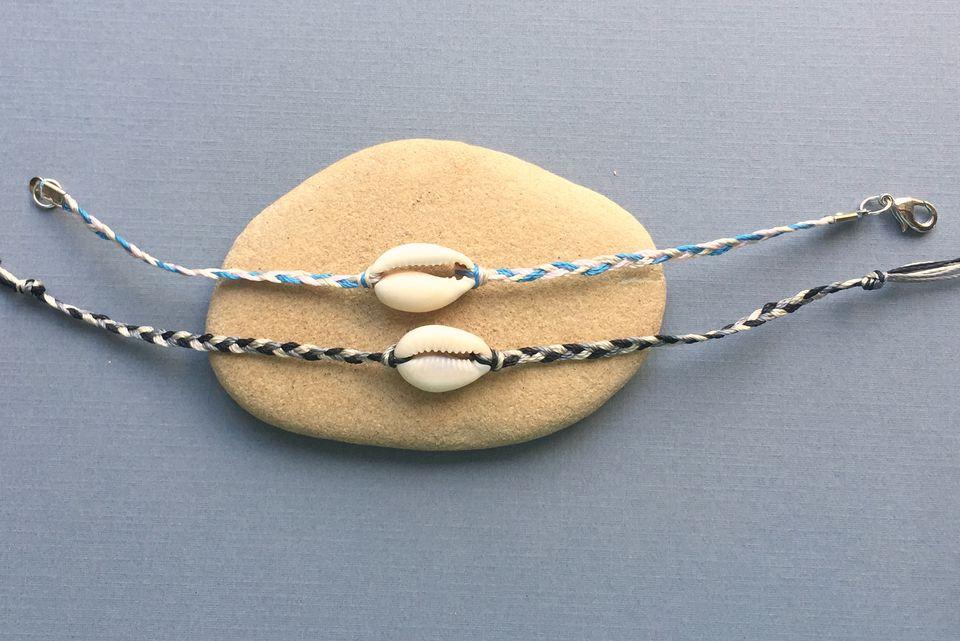 Two braided shell bracelets