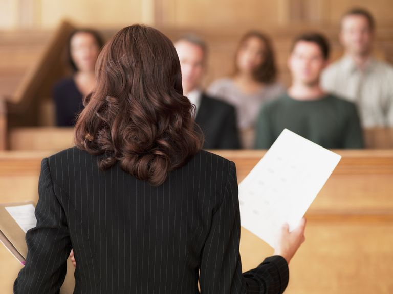 Lawyer holding a document in courtroom