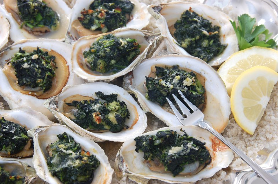 A delicious Oysters Rockefeller with fork and lemon
