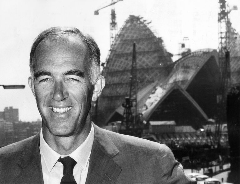 Black and white photo of Jorn Utzon, circa 1965, in front of the Sydney Opera House during construction